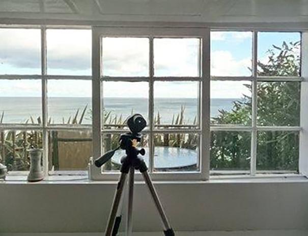 Telescope Next to Window 2
